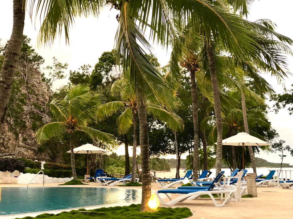 Paradisus Rio del Oro resort pool near stairs leading to the beach.