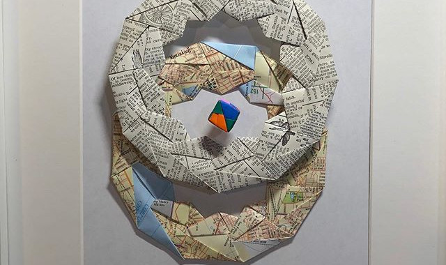 Redefining global harmony. Folded paper