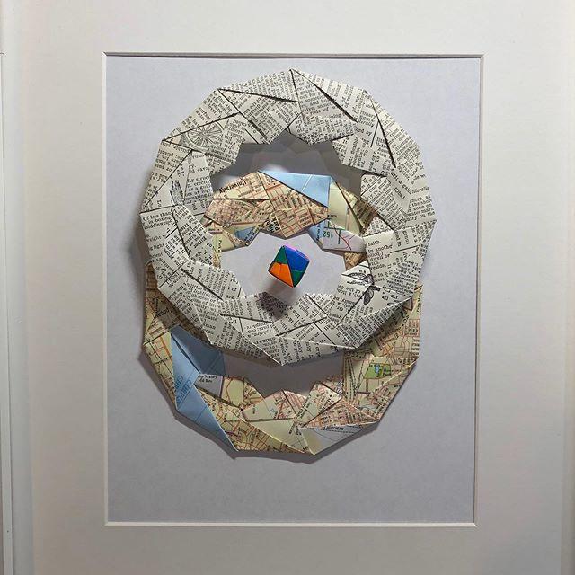 Redefining global harmony. Folded paper