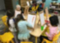 Children painting in art class