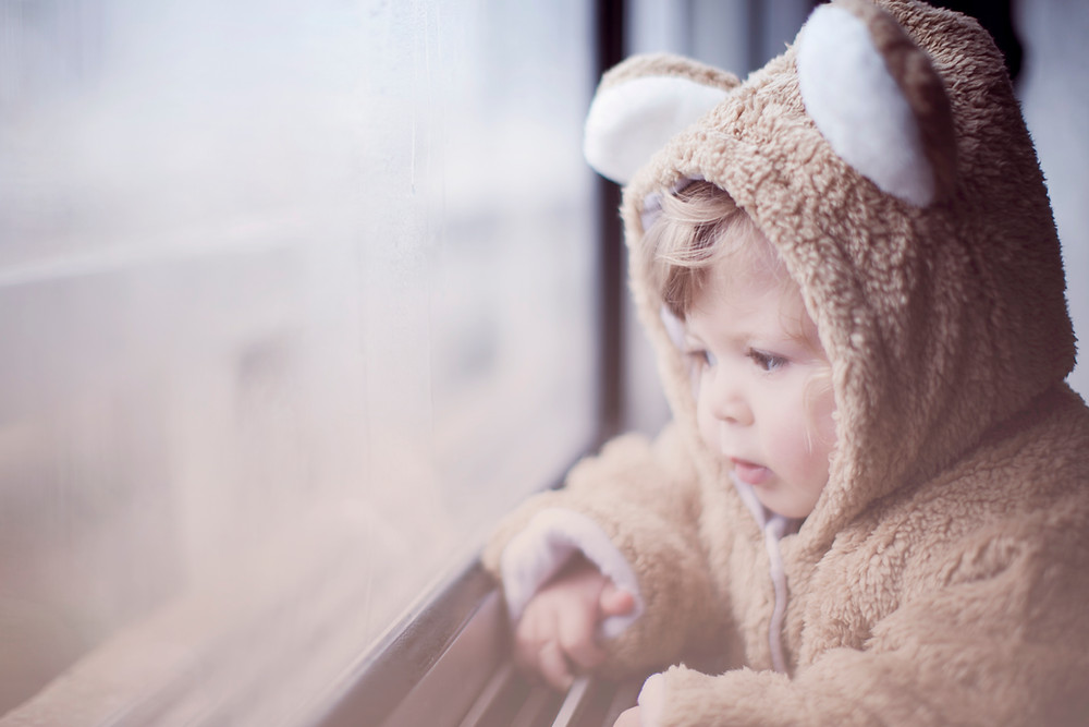 bear costume on small child