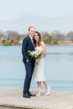 bright and airy wedding couple by lake in bay head nj
