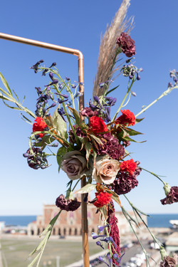 The Asbury Hotel wedding couple rooftop flowers
