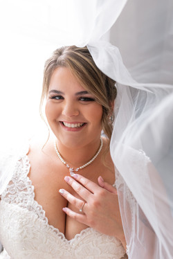 wedding smiling bride veil