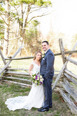 Monmouth battlefield backyard wedding couple against fence