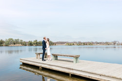 bright and airy wedding couple kissing by lake in bay head nj