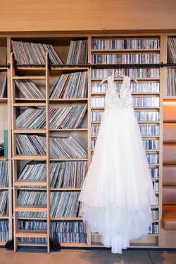The Asbury Hotel wedding dress on bookcase
