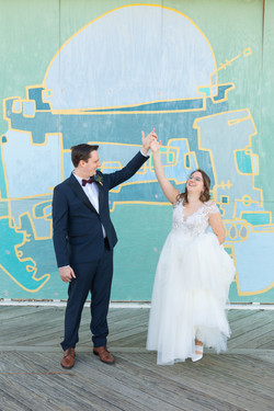 Asbury Park mural wedding couple holding hands