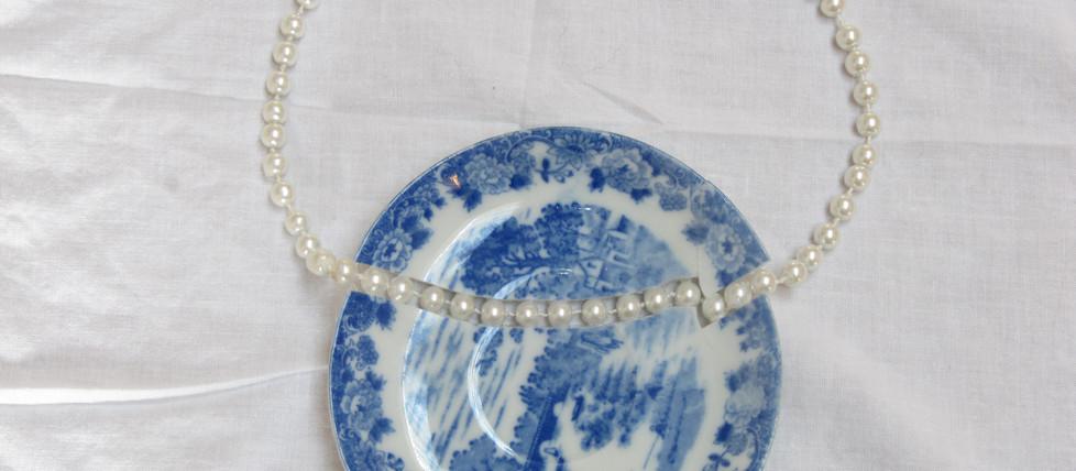 Repair, porcelain plate, artificial pearls, 2017