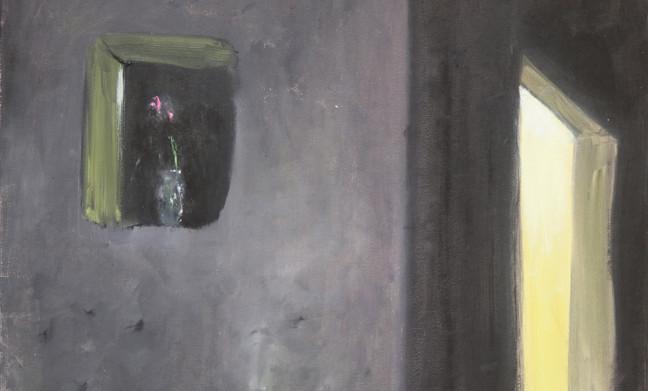 A vase in a dark window