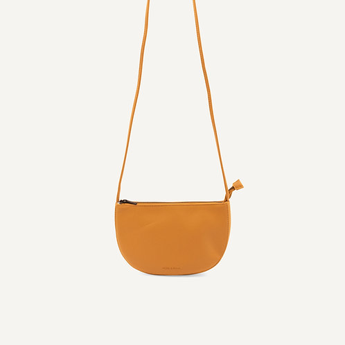 Farou half moon bag • pebbled pu • honey
