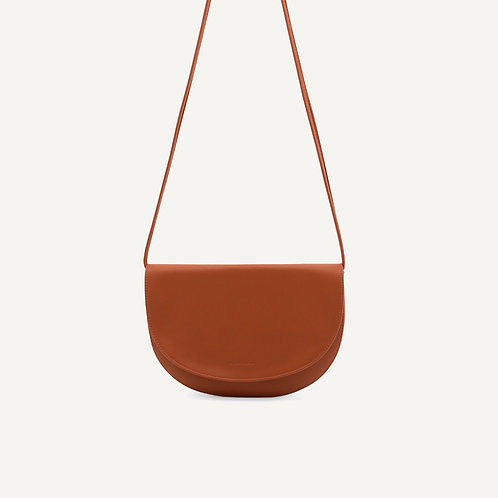 Soma half moon bag • pebbled pu • burnt orange