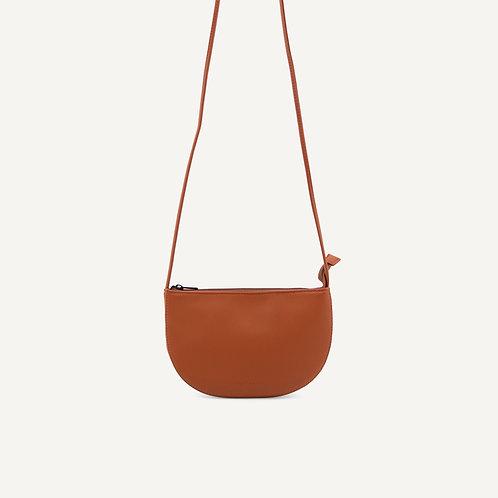 Farou half moon bag • pebbled pu • burnt orange