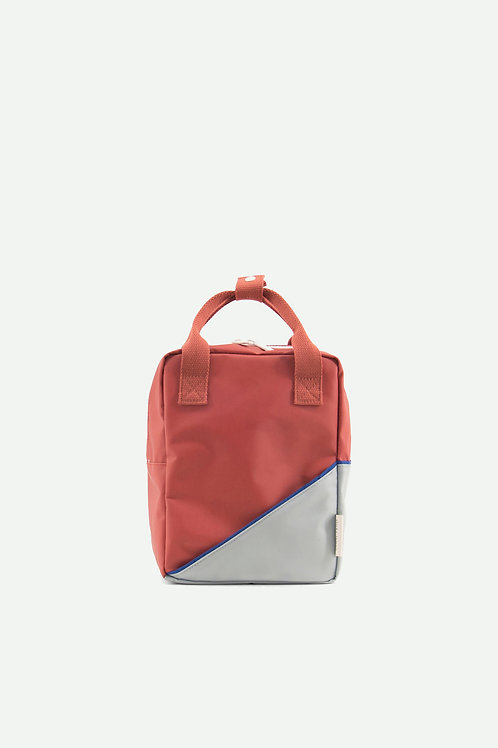 small backpack diagonal | faded red