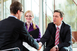 Man having an interview with manager and partner employment job candidate hiring