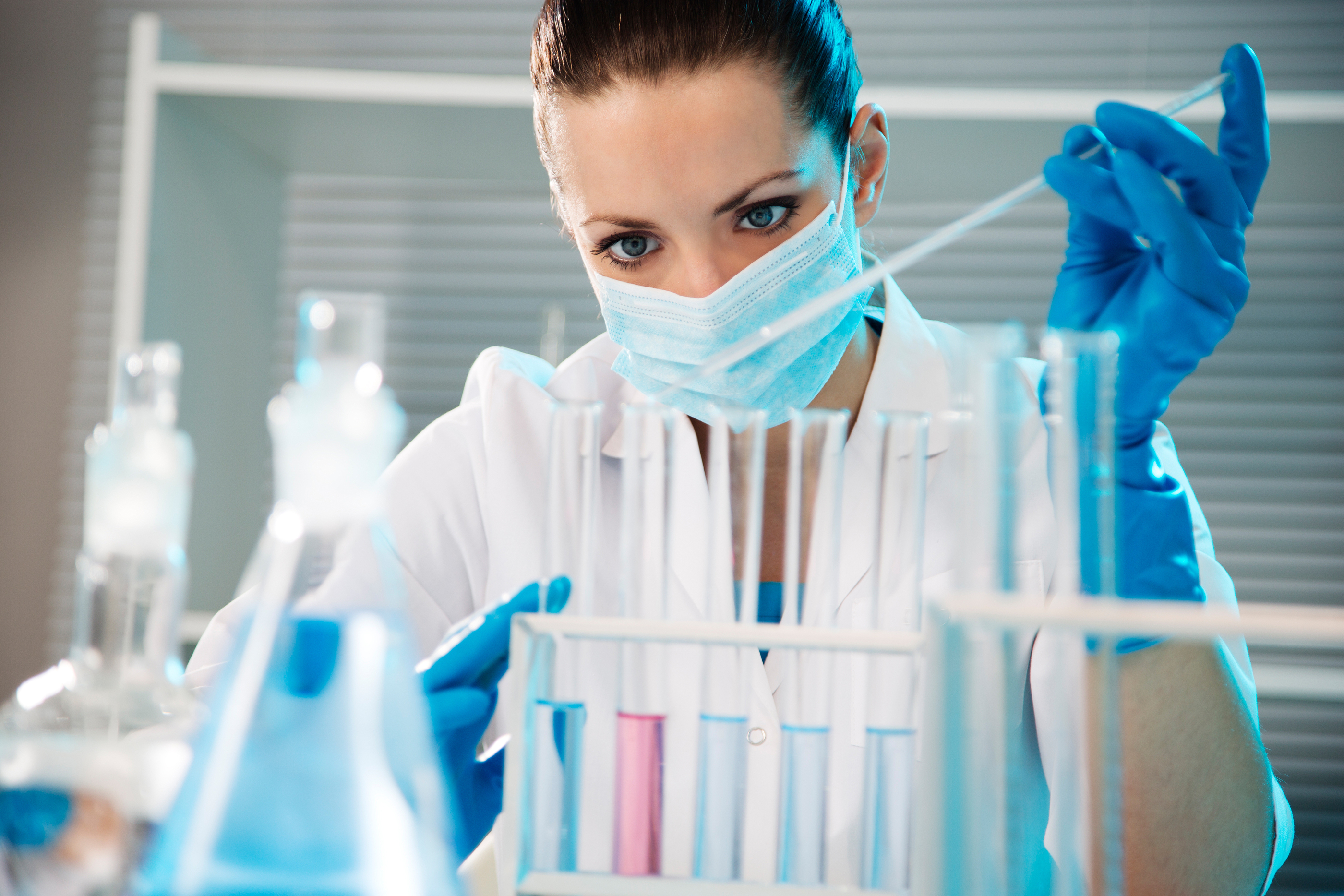 Attractive young female scientist working in laboratory.jpg
