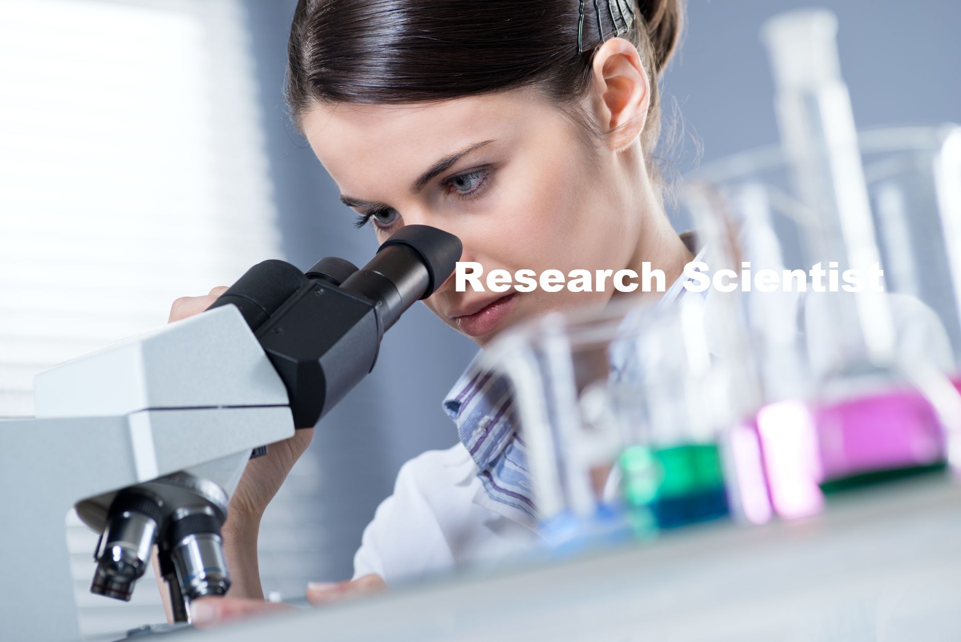 Female Researcher Using Microscope_edited.jpg