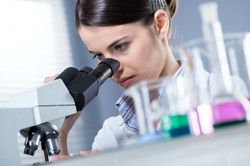 Female Researcher Using Microscope.jpg