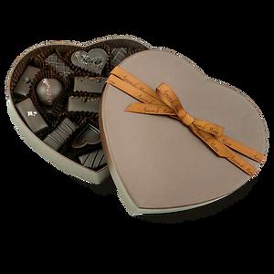 Vegan chocolate, caramel, and ganache assortment in brown heart