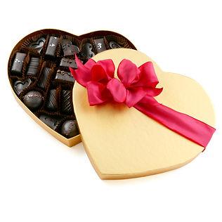 Vegan chocolate, caramel, and ganache assortment in gold box