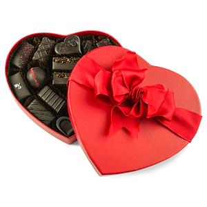 Vegan chocolate, caramel, and ganache assortment in red heart
