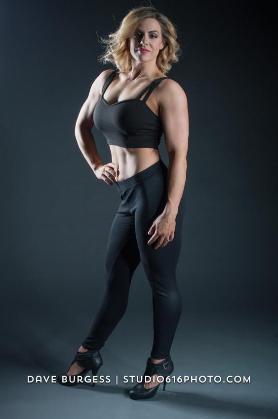 Sarah, in black on black backdrop