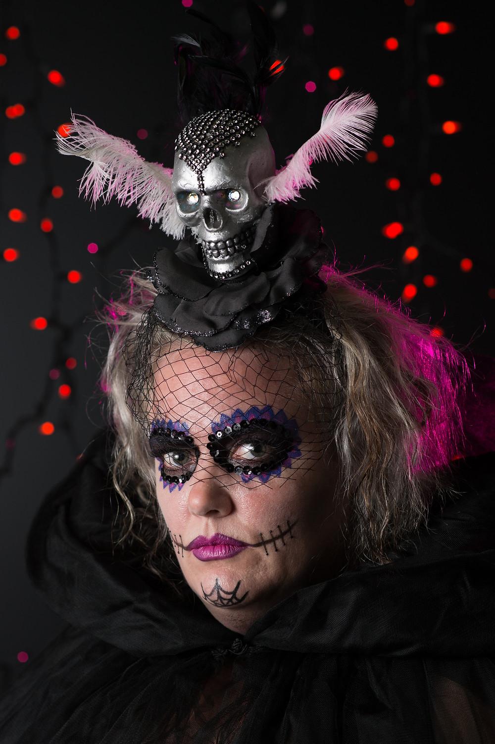 Heidi with elaborate makeup and skull headpiece