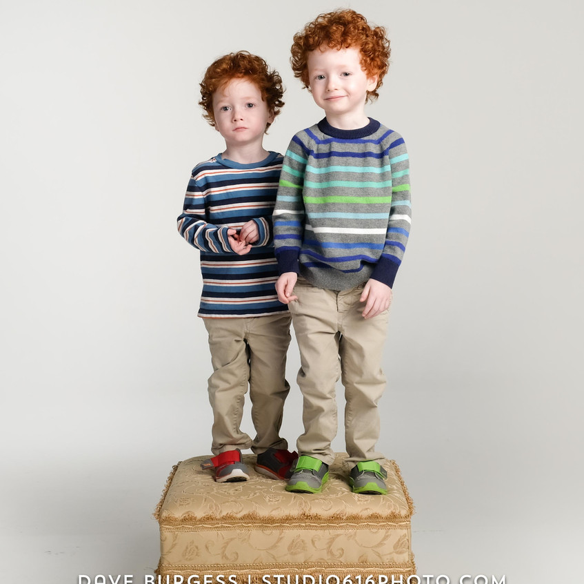 Twins standing on the furniture