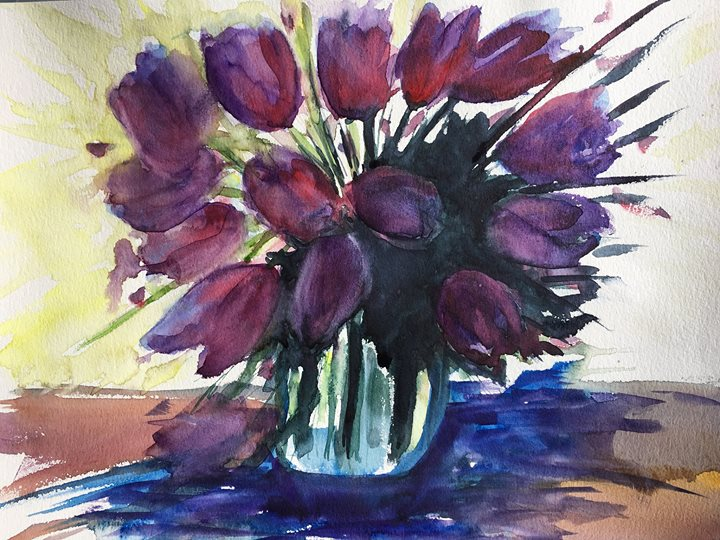 Purple tulips in vase