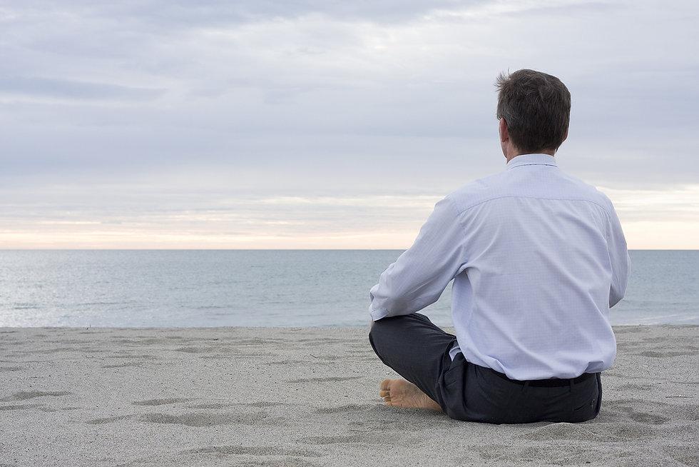 bigstock_Businessman_Meditating_At_The__