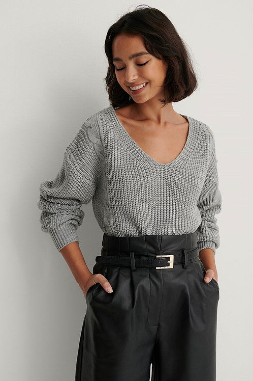 Long cable knitted sweater