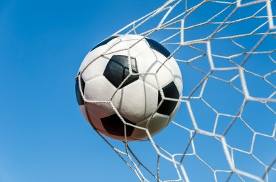 Football in a Goal Net with the Sky