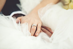 Wedding dress, hands and wedding rings