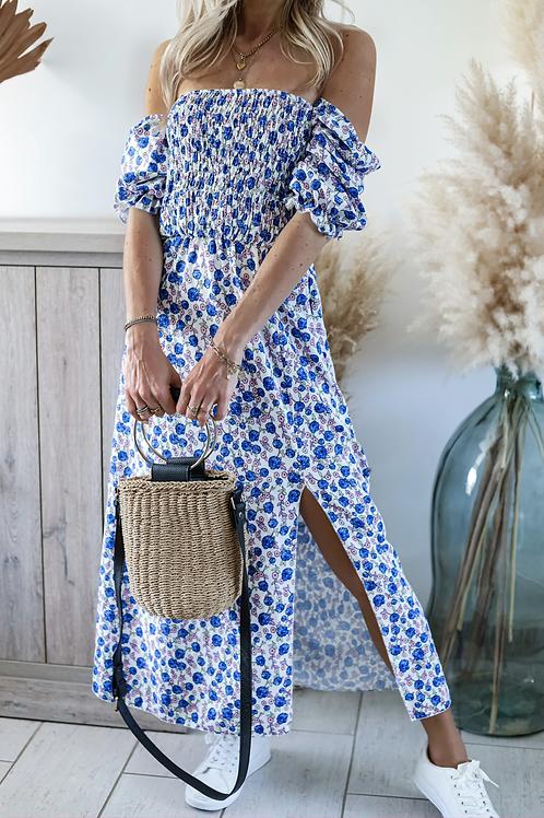 Robe longue avec un motif de fleur bleu. grecy