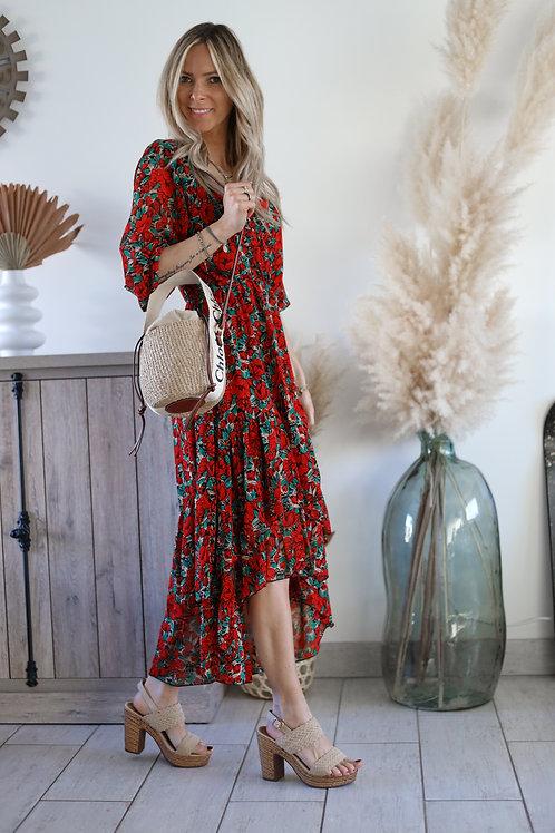 Robe longue de couleur rouge avec un imprimé fleuri asymétrique . Grecy