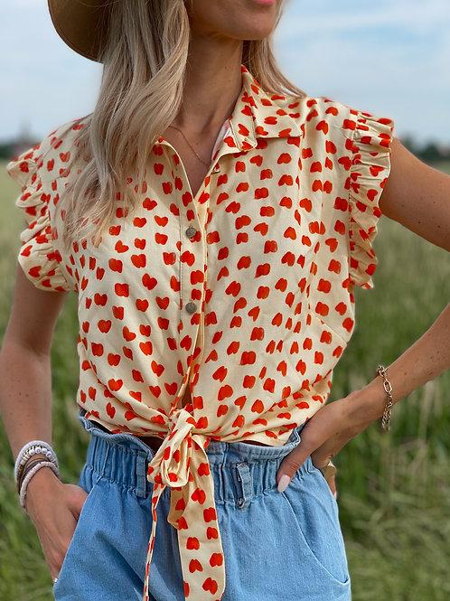 """Chemise à motif """"coeur"""". Se ceinture avec les deux liens."""