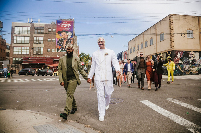 Josh  & Wil cross the street