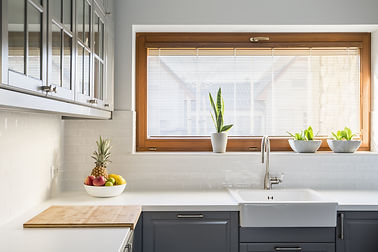 Light kitchen with white countertop, sin