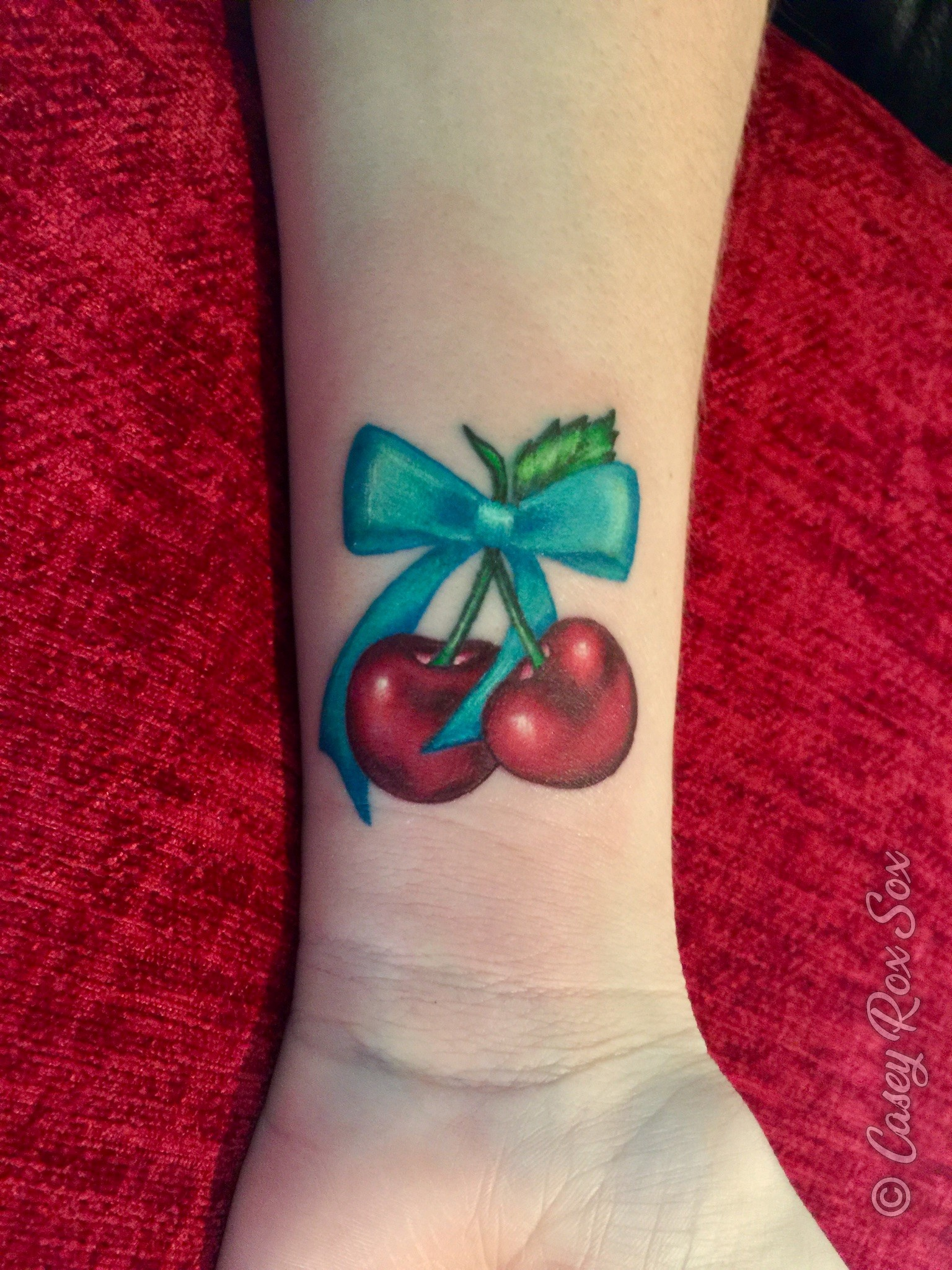 Cherries with bow