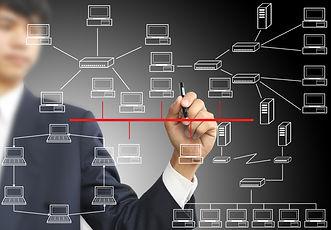 Man sketching computer network.jpg