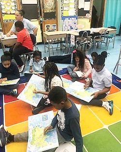 Students of 301 using maps to identify t