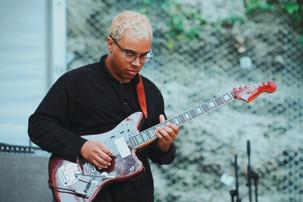 Guitarist shreds.