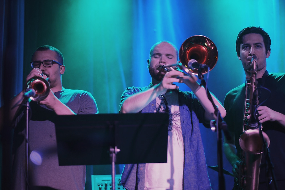 Brass section plays in unison.