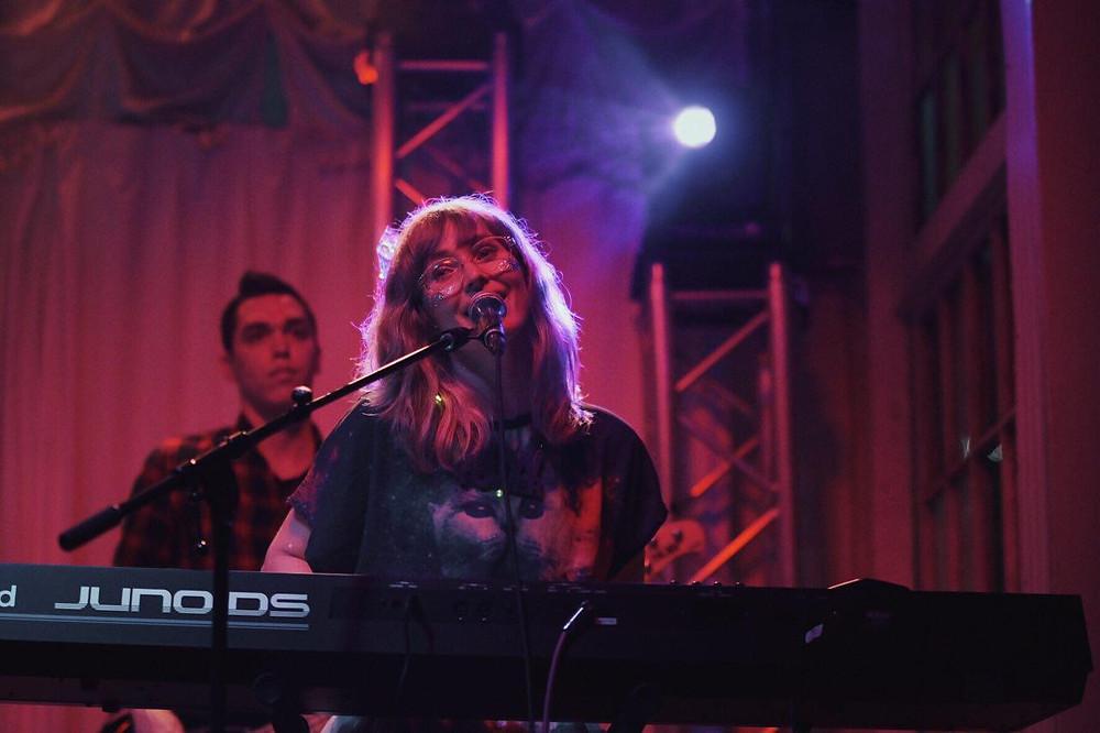 Girl playing keyboard.