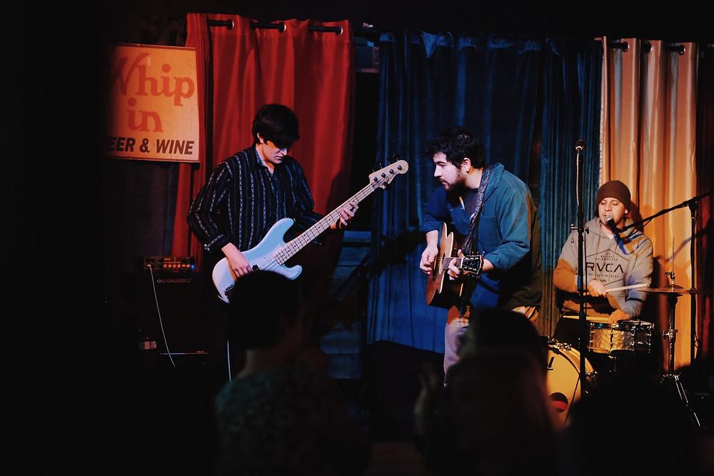 Band plays at dive bar.