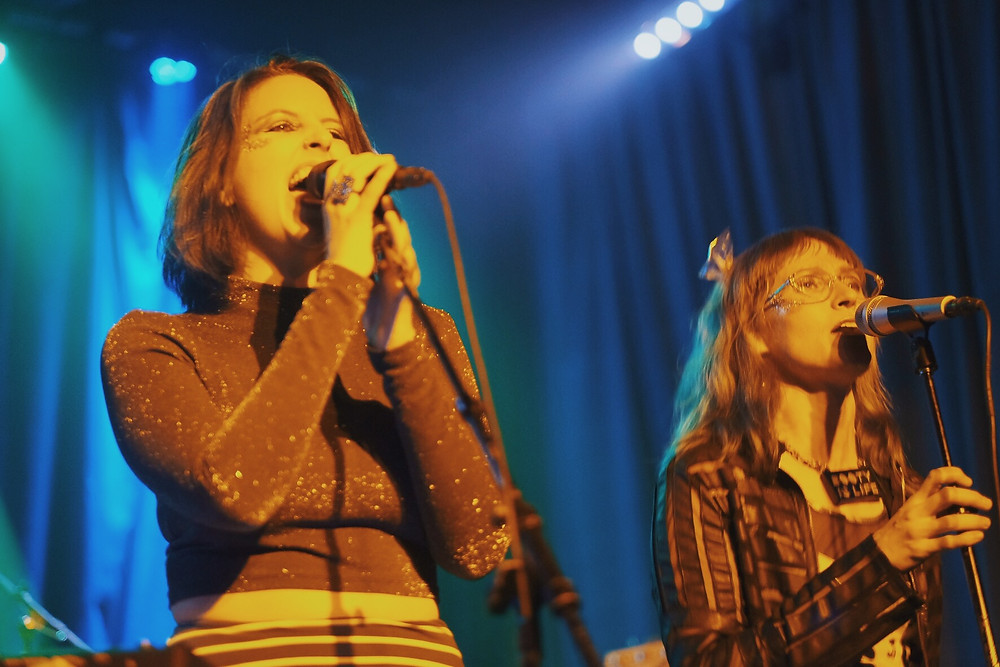 Female vocalists perform live.