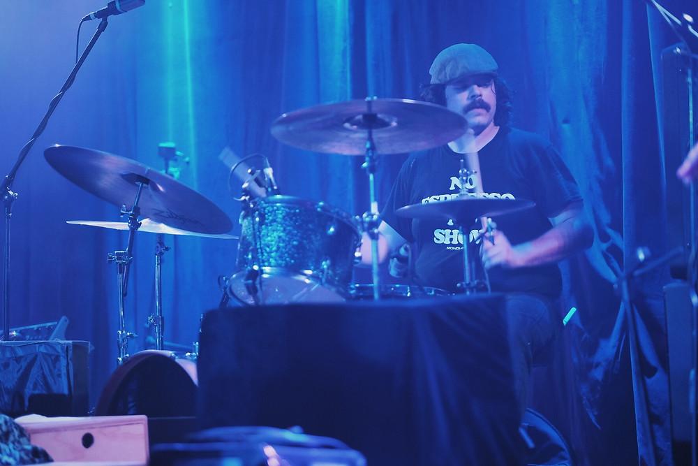 Drummer grooves live.