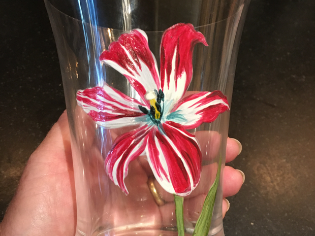 Water glass hand painted with tulip. all glass paint is top rack dishwasher safe