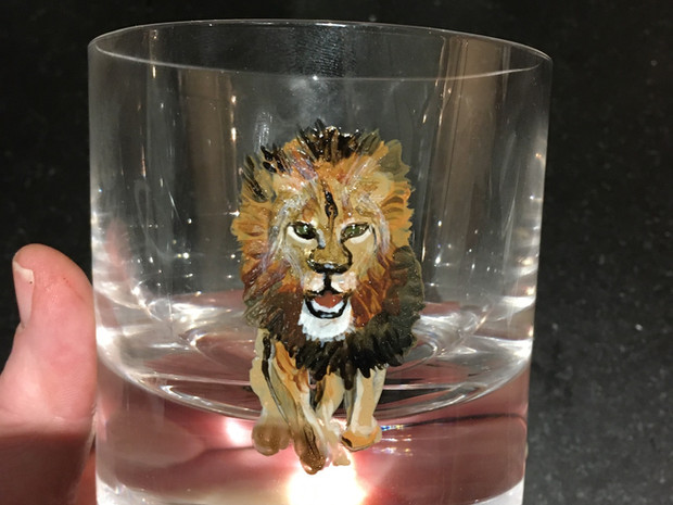 Old fashioned glass hand painted with a lion. paint is top rack dishwasher safe