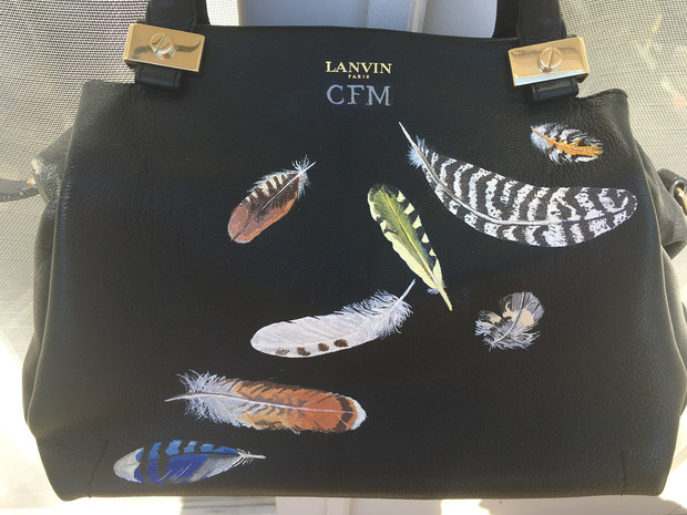Lanvin bag painted with various feathers and client's initials